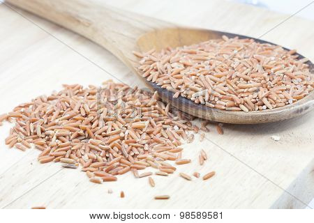 Uncooked Thai Brown Rice In Ladle  , Rice Healthy Food