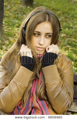 Girl with headphones fall