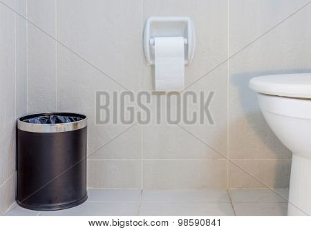 Interior Of Toilet Seat, Paper And Trashcan In Hygiene Restroom.
