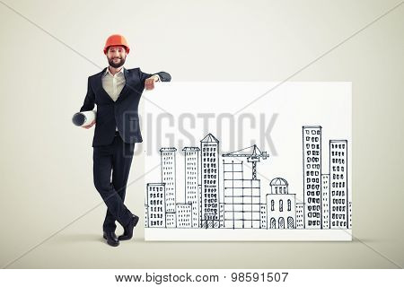 smiley businessman in orange helmet standing near banner with drawing cityscape