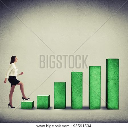 smiley businesswoman climbing diagram over grey background