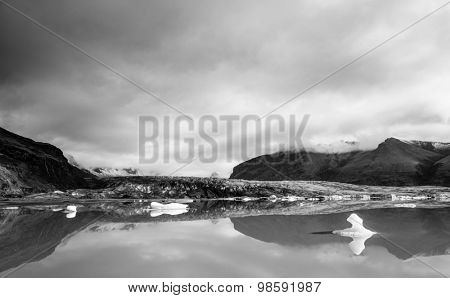 Fjallsarlon lagoon at a glacier terminus in the south of Iceland. Black and white image