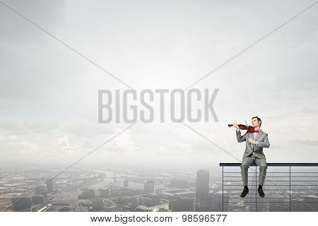 Businessman play violin