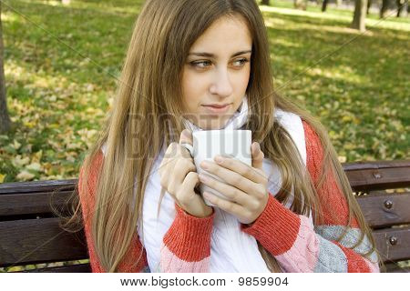 Girl holding coffee cup and smiling