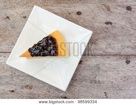 Blueberry Cheese Cake In White Square Dish On The Wood Table