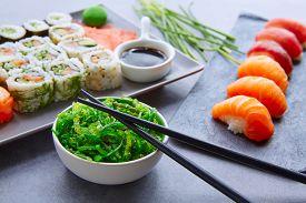 picture of soy sauce  - Sushi Maki and Niguiri California roll with seaweed chuka salad soy sauce and wasabi - JPG