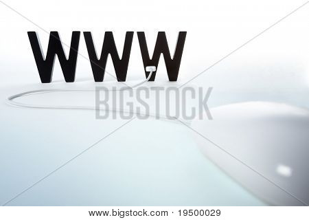 Computer mouse connected to WWW letters symbolizing browsing or surfing the internet, isolated on blank background.