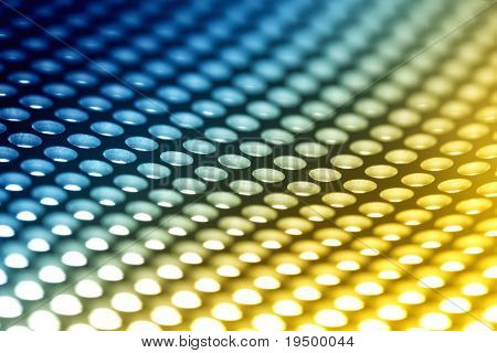 Abstract background: Colorful perforated bent metal sheet grid.