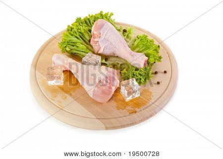 Fresh and frozen chicken legs, isolated on white background, clipping path included