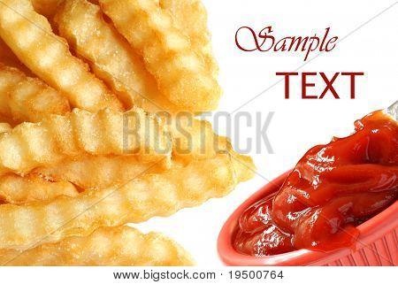 Crinkle cut french fries with ketchup on white background with copy space.  Montage of two macros blended together.  Shallow dof.