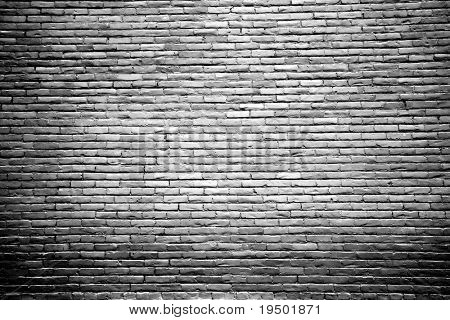 Black and White Brick Wall Background with Highlighted Center
