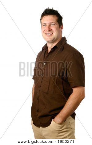 Confident  Young Man In Brown Casual Top Smiling