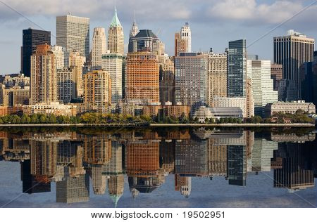 Lower Manhattan with water reflection in Hudson River.