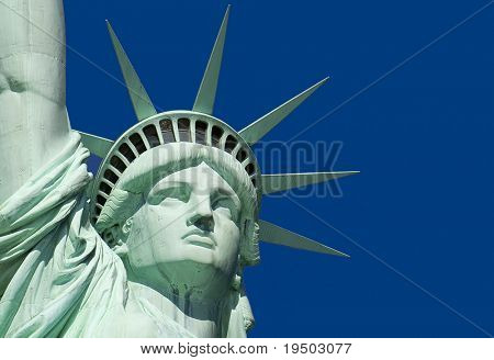 Close-Up of Statue of Liberty against a clear blue sky.
