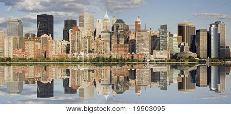Panorama of Manhattan skyline with water reflection