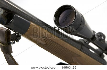 Sniper rifle with scope isolated on white background.