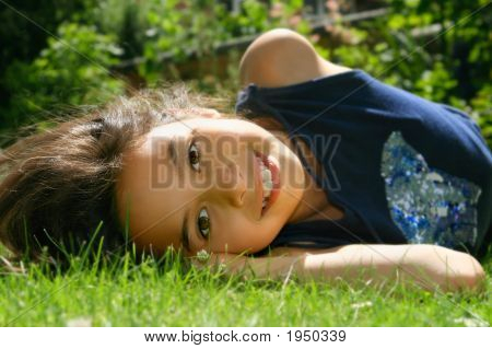 Young Girl Enjoying The Summer Sunshine