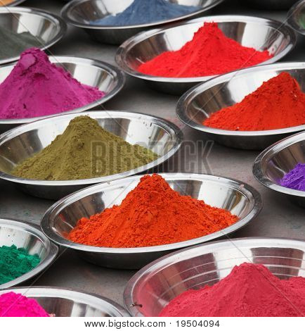 Coloured powders at market in Orchha, India