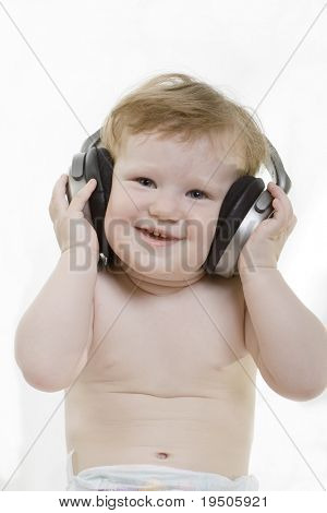 little child with a headphones