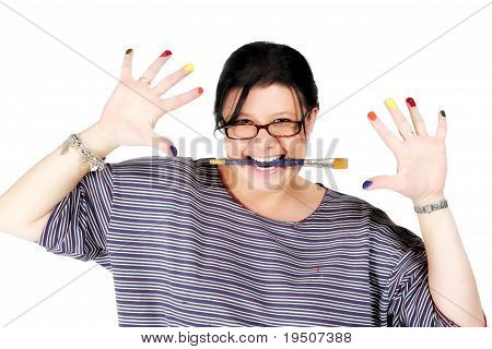 Female Artist Holding Paintbrush In Mouth