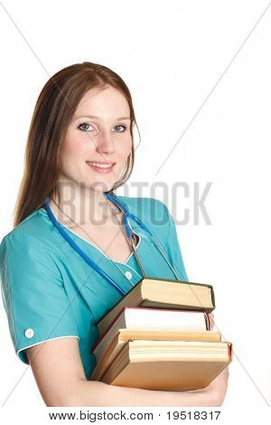The portrait of kind female doctor in the green uniform with books