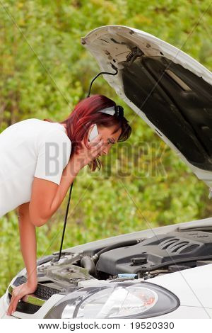 Adult caucasian woman in her car breaks down. Engine failure.