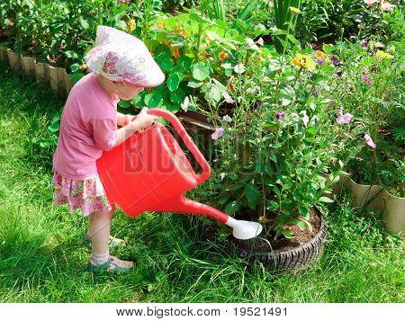 Little gardener with a bailer