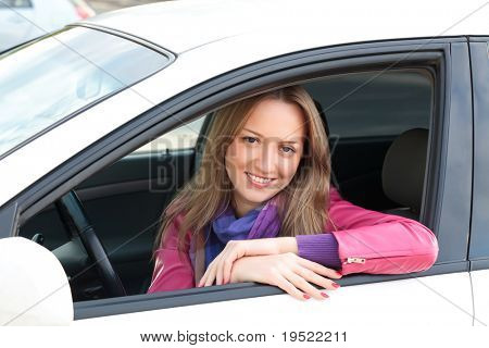 Pretty Young Woman Sitting In Car.