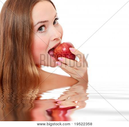Pretty girl with open mouth eating red ripe apple