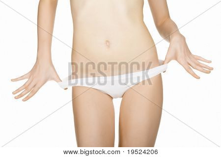 Belly of beautiful and slim young caucasian lady, isolated on white background