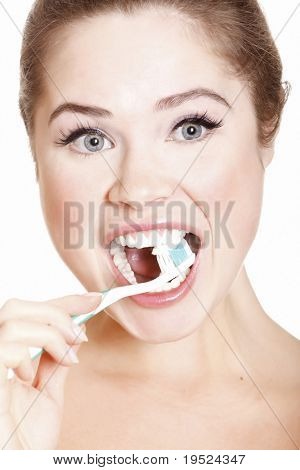 Beautiful Girl Brushing her Teeth, isolated on white background.
