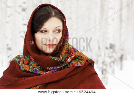 Pretty woman in red shawl
