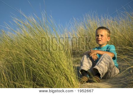 Boy In The Dunes Thinking