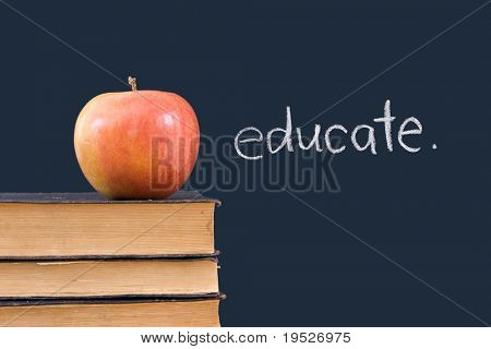 """educate"" written on chalkboard with red apple & books"