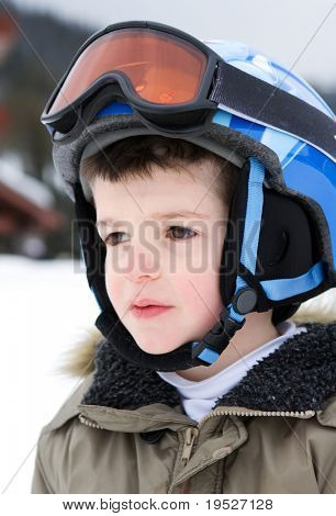 boy in ski gear - helmet & goggles closeup