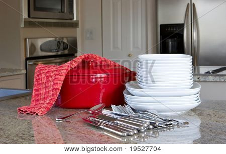 mealtime - red casserole and dishes in modern kitchen
