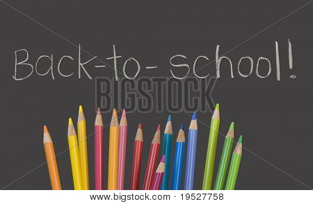 """""""back to school"""" written on chalkboard with multicolored pencil crayons"""