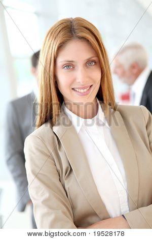 Portrait of beautiful businesswoman standing in hall
