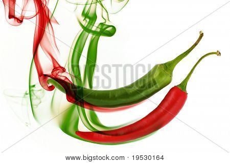 red and green hot chili pepper with color smoke on white