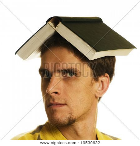 man with open book on head on white background