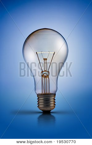 tungsten light bulb lamp on blue background