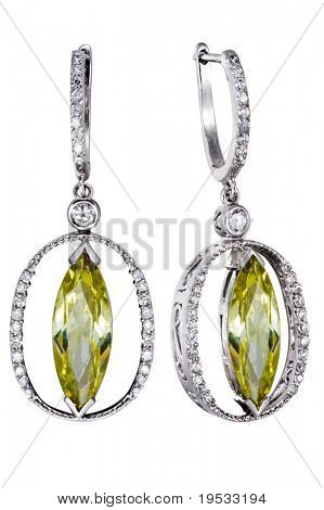 Close-up earrings with  green zircon isolated on white background