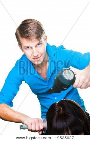 man hairdresser working with hair dryer