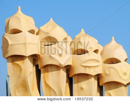 Abstract chimneys atop Antonio Gaudi's La Pedrera in Barcelona, Spain.  Built in 1906-1910.