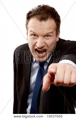 An angry businessman pointing at you