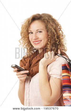 Portrait of an attractive young woman with shopping bags isolated on white background