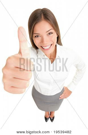 Thumbs up success woman happy smiling. High angle view of young successful mixed race Asian Caucasian businesswoman isolated in full body on white background.