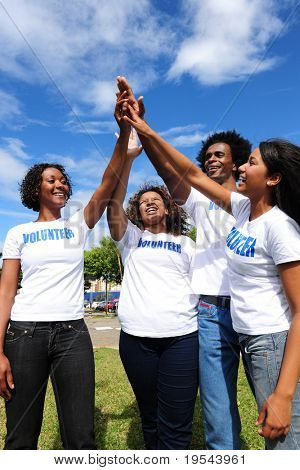 African american volunteer group giving high five