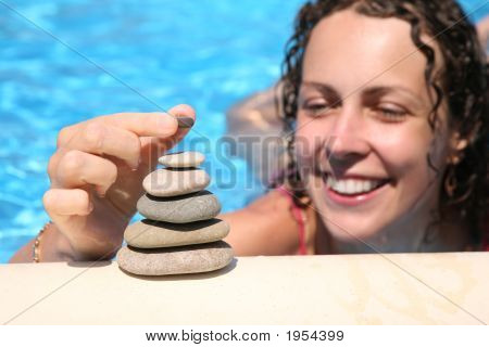 The Woman Builds A Figure Of Stones