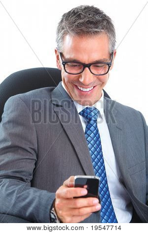 Handsome smiling businessman with smartphone. Isolated over white background